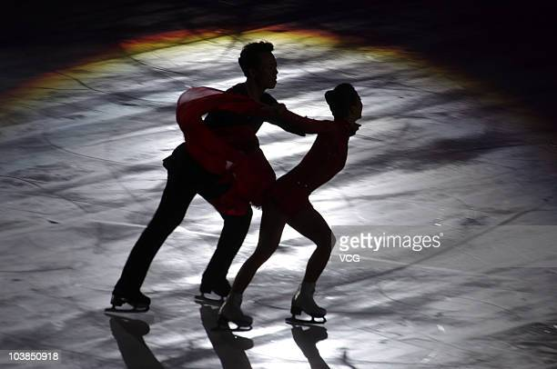 China's first Olympic champion figure skaters Shen Xue and Zhao Hongbo in wedding outfits skate as they enjoy their longdelayed wedding party as part...