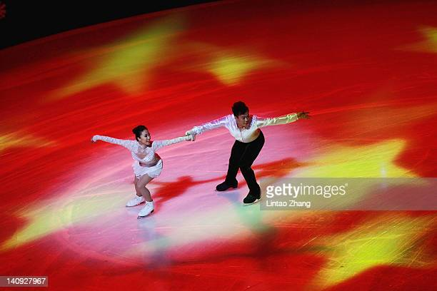 China's first Olympic champion figure skaters Shen Xue and Zhao Hongbo perform on the ice during the opening ceremony of ISU World Short Track Speed...