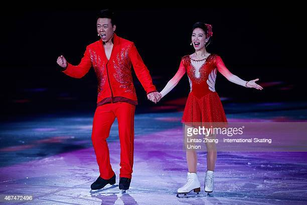 China's first Olympic champion figure skaters Shen Xue and Zhao Hongbo perform on the ice during the opening ceremony of the 2015 ISU World Figure...