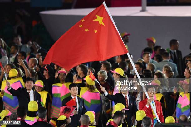China's flag bearer Lei Sheng leads his national delegation during the opening ceremony of the Rio 2016 Olympic Games at the Maracana stadium in Rio...