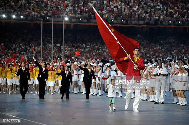 China's flagbearer NBA basketball player Yao Ming carries the flag of China during the Beijing 2008 Olympic Games opening ceremony in the Bird's Nest...