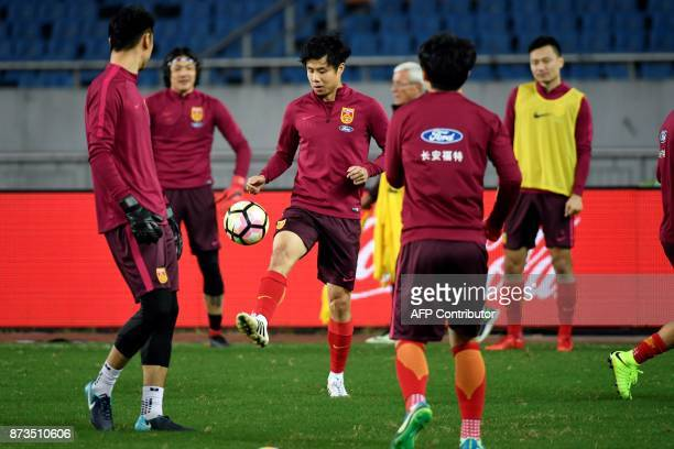 China's football players take part in a training session in Chongqing southwest China on November 13 ahead of their international friendly football...