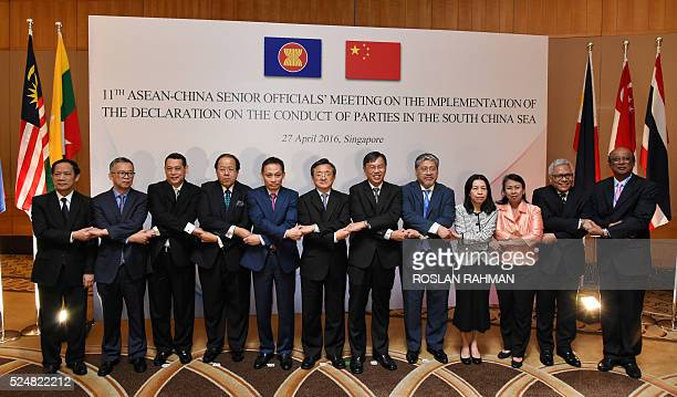 China's Foreign Affairs Vice Minister Liu Zhenmin poses for a group photograph with ASEAN senior officials Lao Minister in the Governments Office...