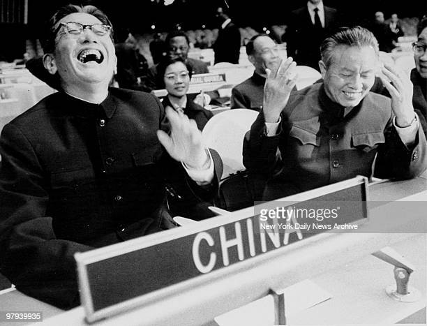 China's Foreign Minister Chiae Kuan-Hua and China's U.N. Representative Huang Hua laugh as they take their seats at the United Nations General...