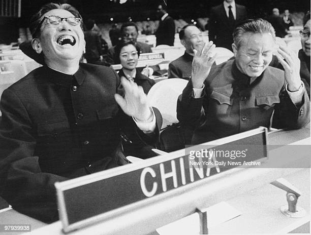 China's Foreign Minister Chiae Kuan-Hua and United Nations representative Huang Hua laugh as they take their seats at the UN General Assembly for the...
