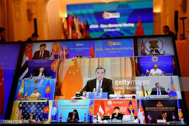 China's Foreign Minister Wang Yi addresses counterparts from the Association of Southeast Asian Nations countries in a live video conference during...