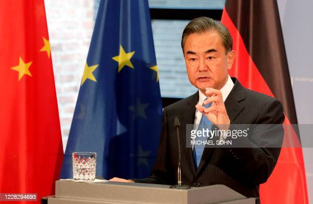 China's Foreign Minister Wang Yi addresses the media during a joint press conference with his German counterpart as part of a meeting in Berlin...