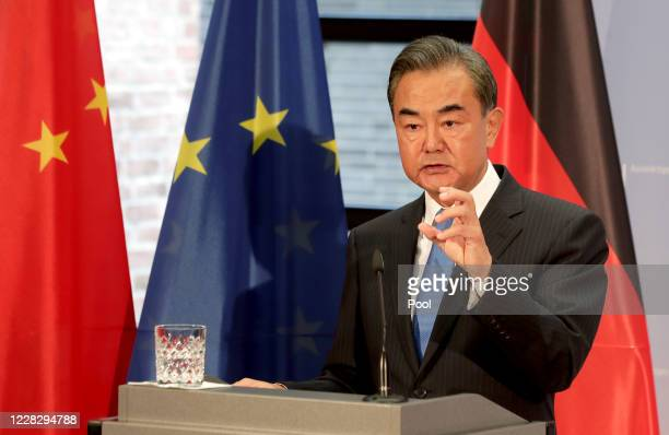 China's Foreign Minister Wang Yi addresses the media during a joint press conference with German Foreign Minister Heiko Maas as part of a meeting on...