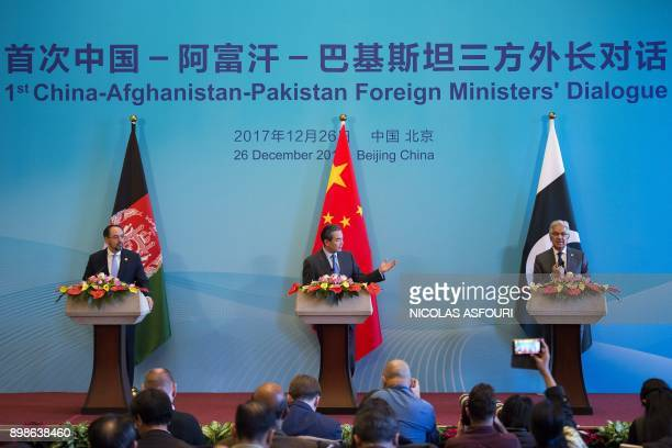 China's Foreign Minister Wang Yi Afghanistan's Foreign Minister Salahuddin Rabbani and Pakistan's Foreign Minister Khawaja Muhammad Asif take part in...