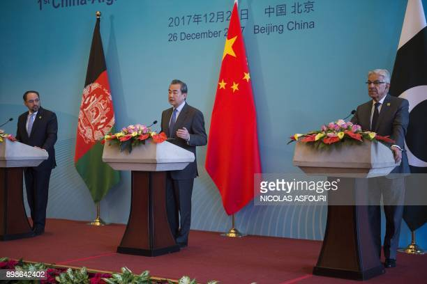 China's Foreign Minister Wang Yi Afghanistan's Foreign Minister Salahuddin Rabbani and Pakistan's Foreign Minister Khawaja Muhammad Asif hold a joint...