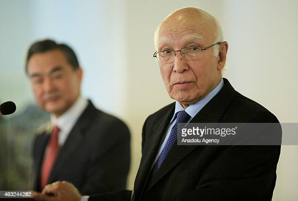 China's Foreign Minister Wang Yi and Adviser to Pakistans Prime Minister on National Security and Foreign Affairs Sartaj Aziz hold a joint press...