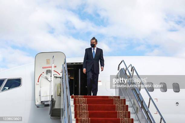 China's Foreign Minister Wang Yi arrives at Chinggis Khaan International Airport in Ulaanbaatar the capital of Mongolia on September 15 2020 Protests...