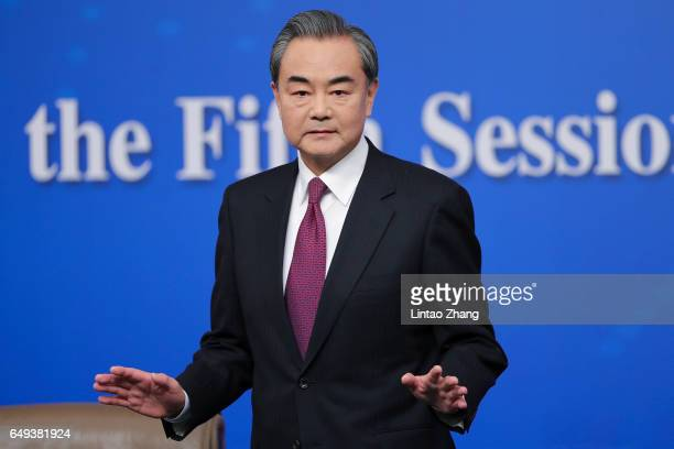China's foreign minister Wang Yi attends a press conference at Media Center on March 8 2017 in Beijing China In May 2017 Beijing held the Belt and...