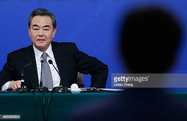 China's foreign minister Wang Yi attends a press conference during the Third Session of the 12th National People's Congress on March 8 2015 in...