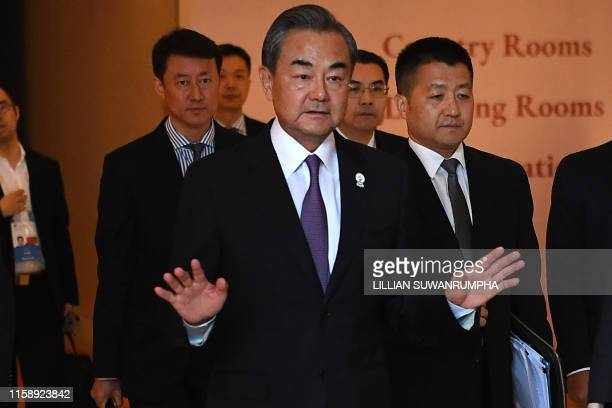 China's Foreign Minister Wang Yi gestures as he approaches the media after meeting US Secretary of State Mike Pompeo on the sidelines of the 52nd...