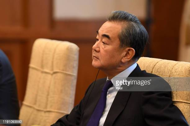 China's Foreign Minister Wang Yi listens to Iran's Foreign Minister Mohammad Javad Zarif during a meeting at the Diaoyutai state guest house on...