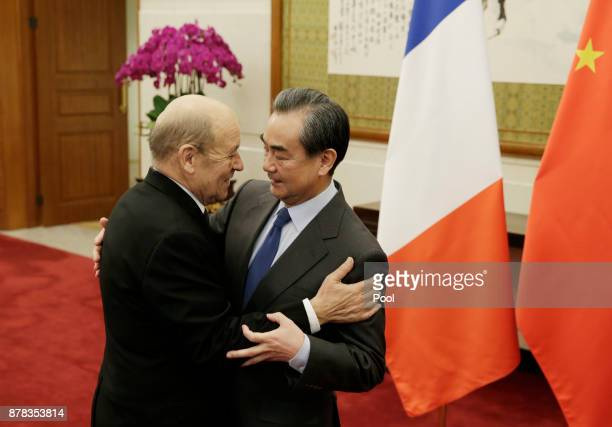 China's Foreign Minister Wang Yi meets French Foreign Minister JeanYves Le Drian at Diaoyutai State Guesthouse on November 24 2017 in Beijing China