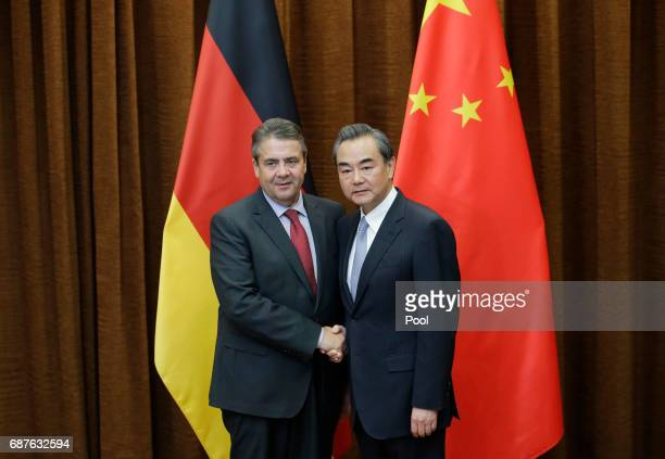 China's Foreign Minister Wang Yi meets German Foreign Minister Sigmar Gabriel at the Ministry of Foreign Affairs on May 24 2017 in Beijing China...