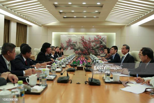 China's Foreign Minister Wang Yi meets with Elizabeth Buensuceso, the Philippine permanent representative for the Association of Southeast Asian...