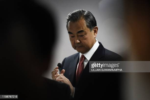 China's Foreign Minister Wang Yi prepares to speak at a press conference on the sidelines of the 52nd Association of Southeast Asian Nations Foreign...