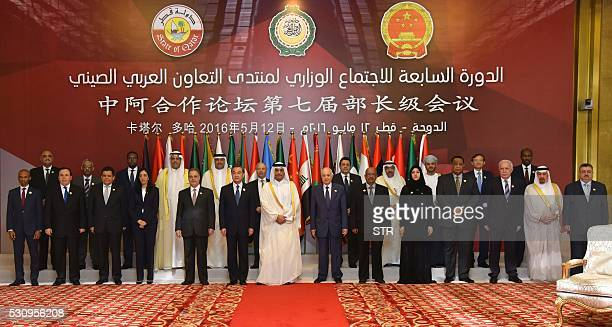 China's Foreign Minister Wang Yi Qatar's Foreign Minister Sheikh Mohammed bin Abdulrahman alThani and Arab League Secretary General Nabil alArabi...