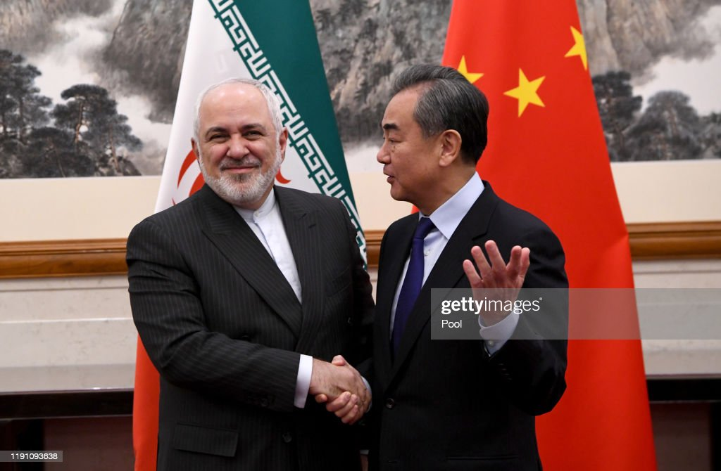 China Foreign Minister Wang Yi and Iran Foreign Minister Mohammad Javad Zarif Meet in Beijing : News Photo