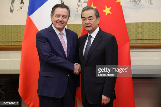 China's Foreign Minister Wang Yi shakes hands with Minister Foreign Affairs of Chile, Roberto Ampuero at Diaoyutai State Guesthouse on September 14,...