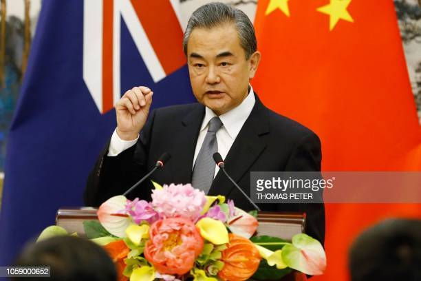 China's Foreign Minister Wang Yi speaks at a news conference with Australia's Foreign Minister Marise Payne at the Diaoyutai State Guesthouse in...