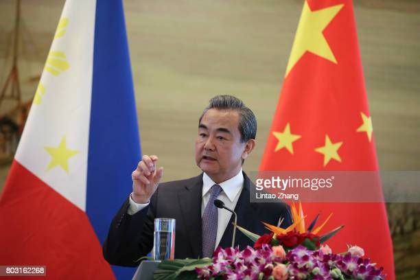 China's Foreign Minister Wang Yi speaks during a joint press conference with Philippine Foreign Affairs Secretary Alan Peter Cayetano at the foreign...