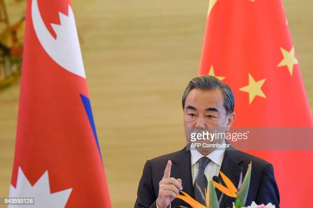 China's Foreign Minister Wang Yi speaks during a press conference after his meeting with Nepal's deputy prime minister at the Ministry of Foreign...