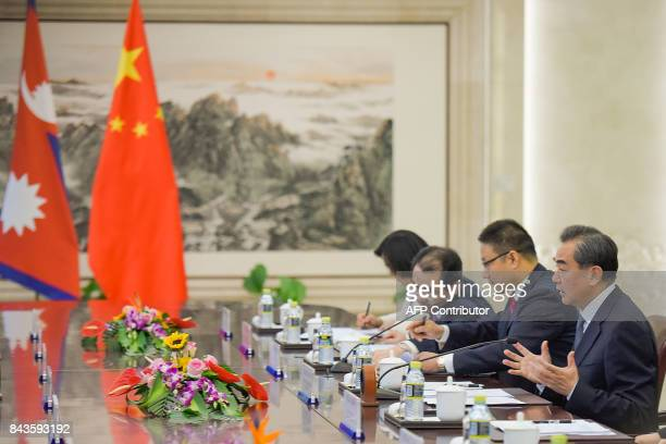 China's Foreign Minister Wang Yi speaks during his meeting with Nepal's deputy prime minister at the Ministry of Foreign Affairs in Beijing on...