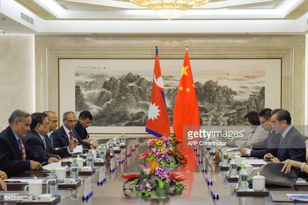 China's Foreign Minister Wang Yi speaks during his meeting with Nepal's Deputy Prime Minister Krishna Bahadur Mahara at the Ministry of Foreign...