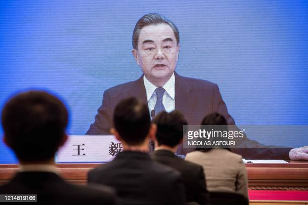 China's Foreign Minister Wang Yi speaks during his online video link press conference during the National People's Congress at the media centre in...
