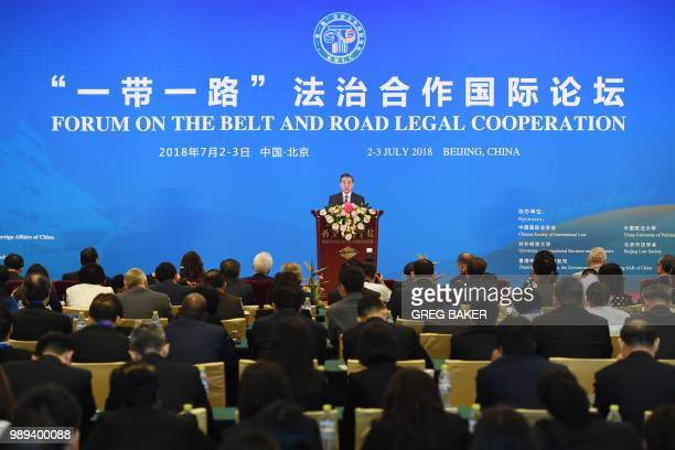 China's Foreign Minister Wang Yi speaks during the opening session of the Belt and Road Forum on Legal Cooperation at the Diaoyutai State Guesthouse...