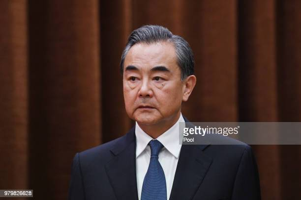 China's Foreign Minister Wang Yi waits for Denmark's Foreign Minister Anders Samuelsen to arrive for a meeting at the Foreign Ministry in Beijing on...