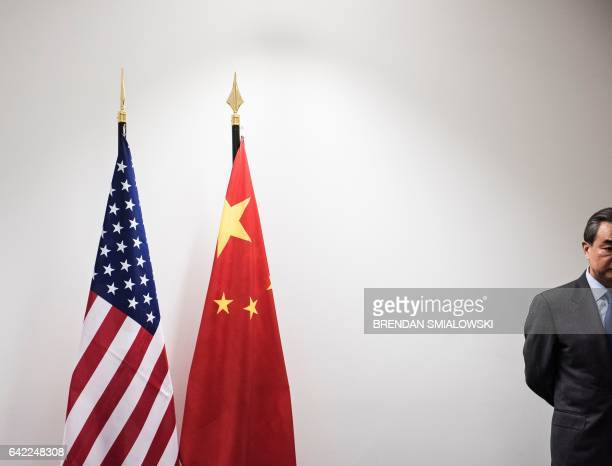 China's Foreign Minister Wang Yi waits for US Secretary of State Rex Tillerson before a meeting on the sidelines of a gathering of Foreign Ministers...