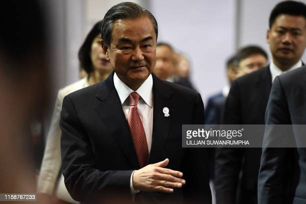China's Foreign Minister Wang Yi walks to a press conference on the sidelines of the 52nd Association of Southeast Asian Nations Foreign Ministers'...