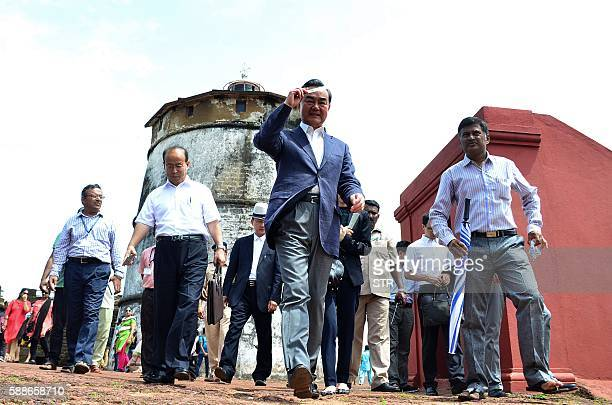 China's Foreign Minister Wang Yi walks with officials during a visit to Fort Aguada in Goa on August 12 2016 Wang Yi is in India for a two day visit...