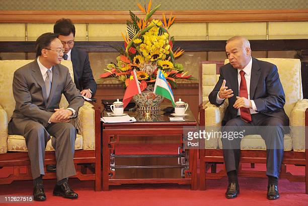 China's Foreign Minister Yang Jiechi and Uzbekistan President Islam Karimov talk during their meeting at the Diaoyutai State Guesthouse on April 20...