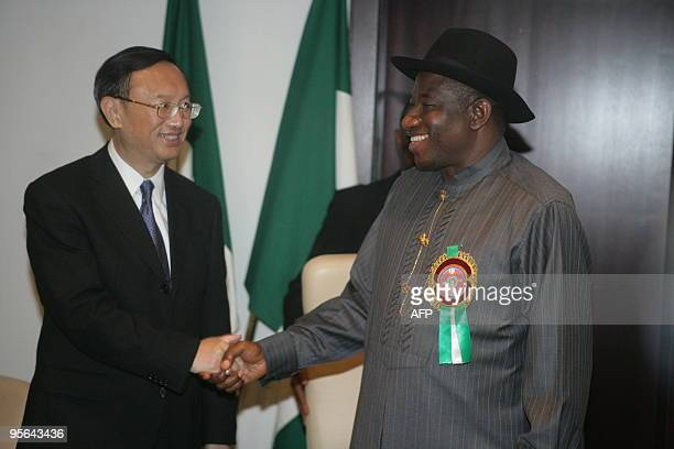 China's Foreign Minister Yang Jiechi shakes hands with Vice President of Nigeria Goodluck Ebele Jonathan during their meeting in Abuja on January 8...