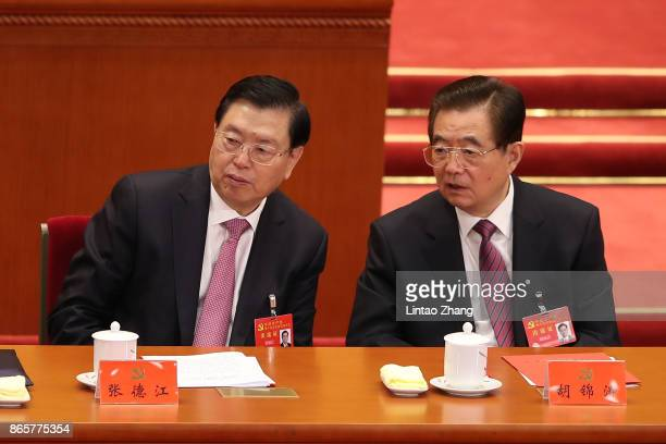 China's former president Hu Jintao talk with The Chairman of the Standing Committee of China's National People's Congress Zhang Dejiang during the...
