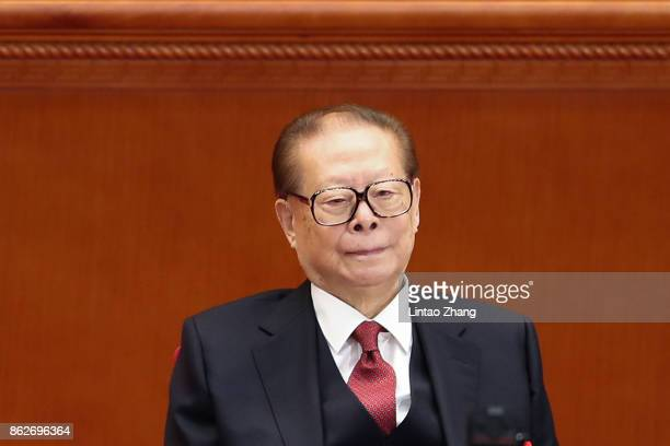 China's former president Jiang Zemin attend the opening session of the Chinese Communist Party's Congress at the Great Hall of the People on October...