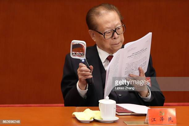 China's former president Jiang Zemin attends the opening session of the Chinese Communist Party's Congress at the Great Hall of the People on October...