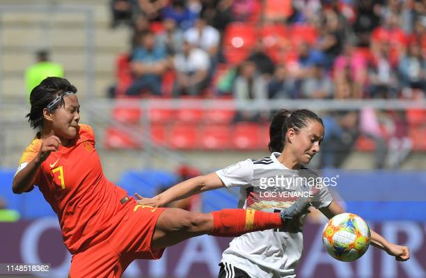 China's forward Shuang Wang vies for the ball with Germany's midfielder Sara Dabritz during the France 2019 Women's World Cup Group B football match...