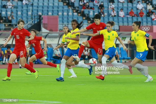 China's forward Wang Shanshan vies for the ball with Brazil's defender Erika during the Tokyo 2020 Olympic Games women's group F first round football...