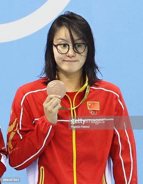 China's Fu Yuanhui holds up her bronze medal for the women's 100meter backstroke at the Summer Olympics in Rio de Janeiro on Aug 8 2016 Fu is popular...