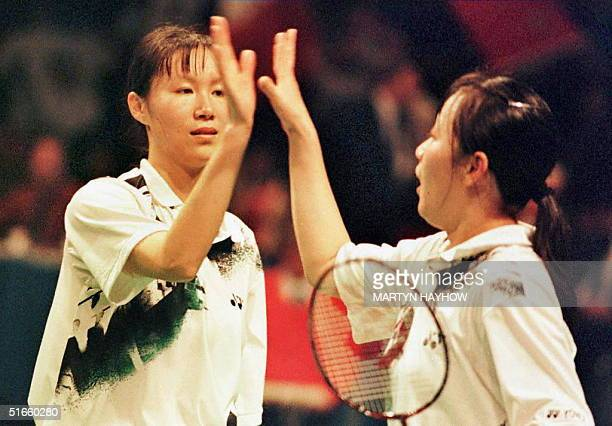China's Ge Fei congratulates her partner Gu Jun both as they win the Ladies Doubles Final of the Yonex All England Open Badminton Championship at...