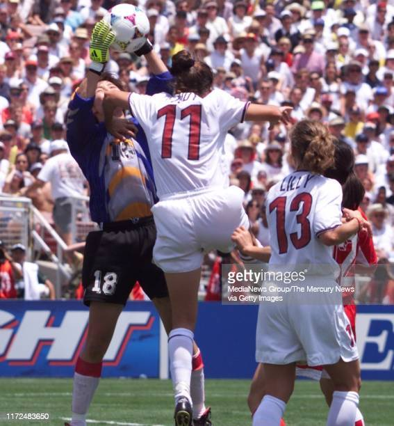 S WORLD CUP FINAL China's goalie Gao Hong makes save as US's Julie Foudy pushes off her in WWC final against China 7/10/99