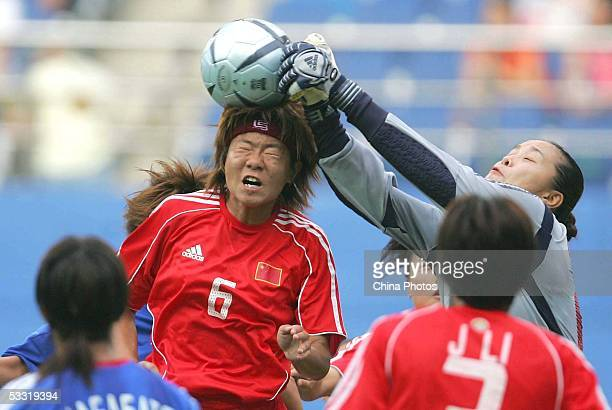 China's goalkeeper Xiao Zhen grabs the ball as Sakai Tomeo of Japan goes for a header during a match in the East Asian Football Federation Women's...