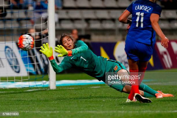 TOPSHOT China's Goalkeeper Zhao Lina misses the ball during the women friendly football match between France and China on July 16 at the Charlety...